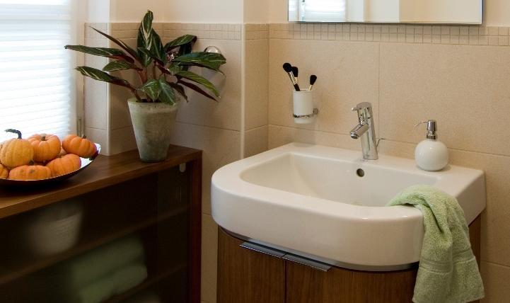 Waschtischunterschrank in der Form des Beckens