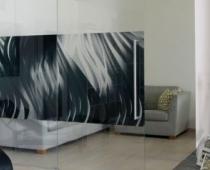 Wohnungsumbau mit Schiebetüren und Trennwänden aus Glas